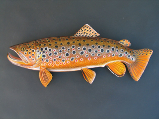 A Variety of Brown Trout Sculptures hand crafted by Lance Marshall Boen. This unique fish art is inspired by Lance's passion for fly fishing. His works of art vary from larger than life leather fish sculptures to an Eagle made from vintage baseball gloves with a wingspan of nearly 12 feet.
