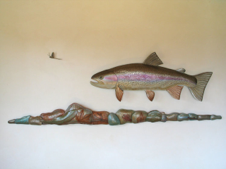 A Variety of Rainbow Trout Sculptures hand crafted by Lance Marshall Boen. This unique fish art is inspired by Lance's passion for fly fishing. His works of art vary from larger than life leather fish sculptures to an Eagle made from vintage baseball gloves with a wingspan of nearly 12 feet.