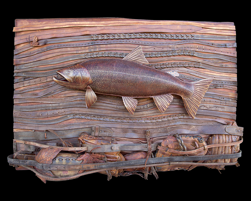 "This River Bed Environment is a one of a kind original hand crafted by Lance Marshall Boen. This three dimensional sculpture is inspired by Lance's passion for fly fishing. Vintage Baseball gloves, hand tooled leaves made of leather, and leather saddle tack form a unique riverbed environment. Serpentine belts and saddle tack are merged together to display the flow of the water current while a 28"" trout lays eyes on an appetizing mayfly."