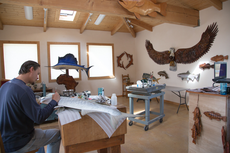 Lance in His Studio painting a 5' Tarpon Sculpture.