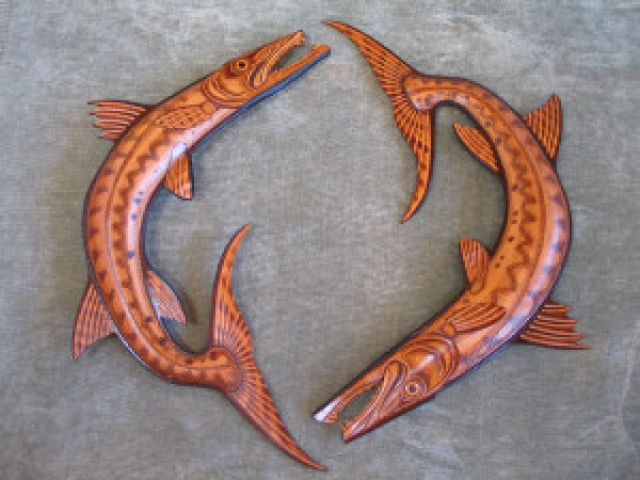 Baracuda Sculpture hand tooled by Lance Marshall Boen. This unique fish art is inspired by Lance's passion for fly fishing. His works of art vary from larger than life leather fish sculptures to an Eagle made from vintage baseball gloves with a wingspan of nearly 12 feet.