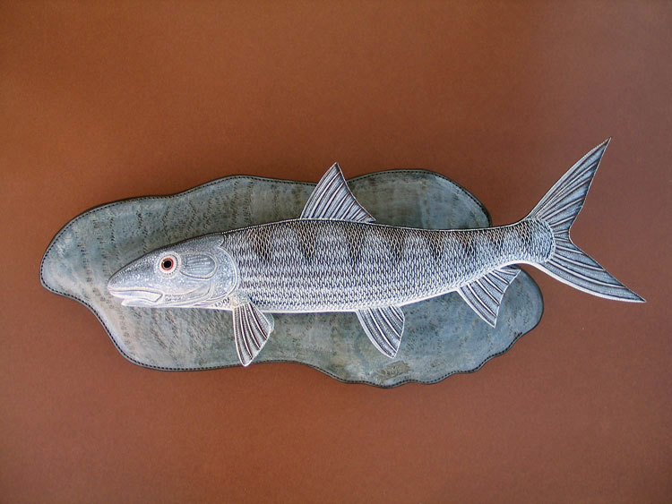 Bonefish Sculpture hand tooled by Lance Marshall Boen. This unique fish art is inspired by Lance's passion for fly fishing. His works of art vary from larger than life leather fish sculptures to an Eagle made from vintage baseball gloves with a wingspan of nearly 12 feet.