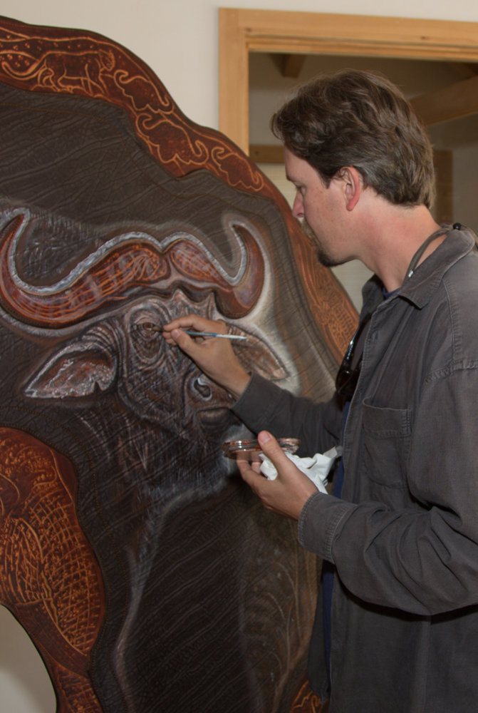 Lance Boen Painting a Cape Buffalo on a Cape Buffalo Hide