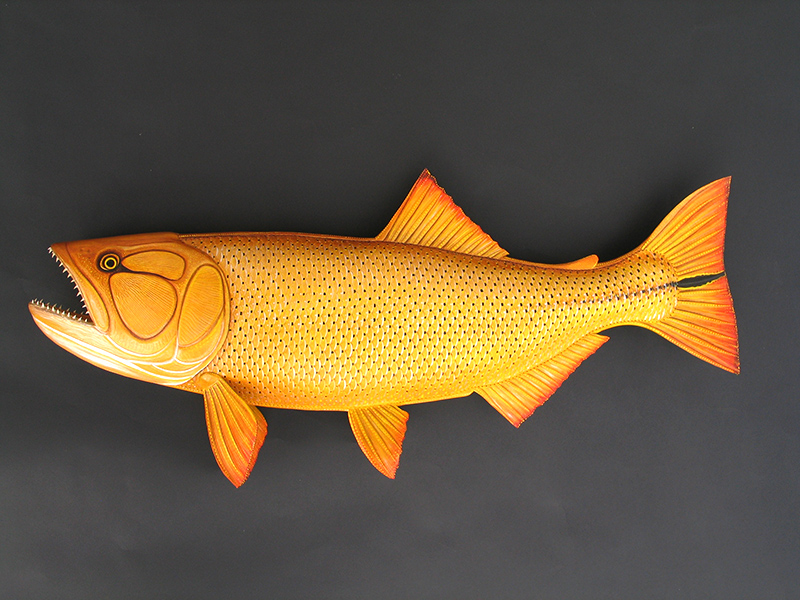 Golden Dorado Sculpture hand tooled by Lance Marshall Boen. This unique fish art is inspired by Lance's passion for fly fishing. His works of art vary from larger than life leather fish sculptures to an Eagle made from vintage baseball gloves with a wingspan of nearly 12 feet.