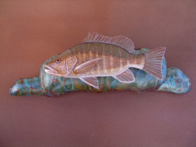 Mangrove Jack Sculpture hand tooled by Lance Marshall Boen. This unique fish art is inspired by Lance's passion for fly fishing. His works of art vary from larger than life leather fish sculptures to an Eagle made from vintage baseball gloves with a wingspan of nearly 12 feet.