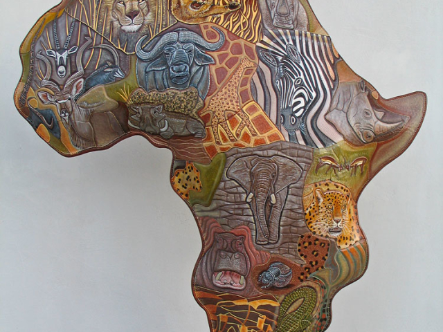 Africa Map hand tooled by Lance Marshall Boen. This unique art is inspired by Lance's passion for wildlife and the outdoors. His works of art vary from larger than life leather fish sculptures to an Eagle made from vintage baseball gloves with a wingspan of nearly 12 feet.