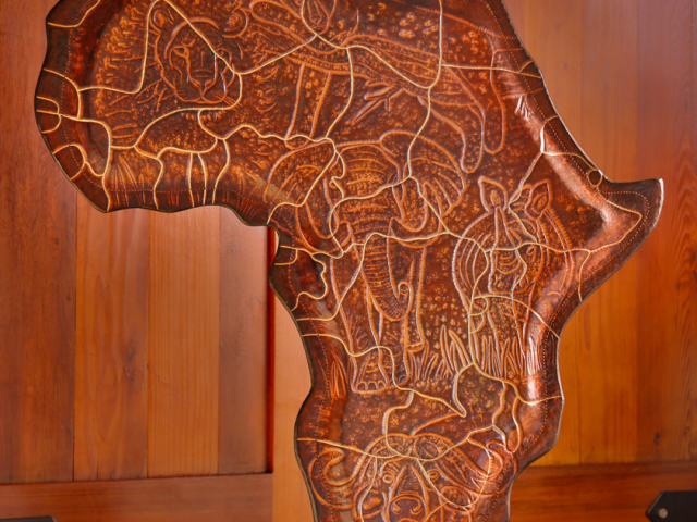 Africa Map hand tooled by Lance Marshall Boen. This unique art is inspired by Lance's passion for wildlife and the outdoors.