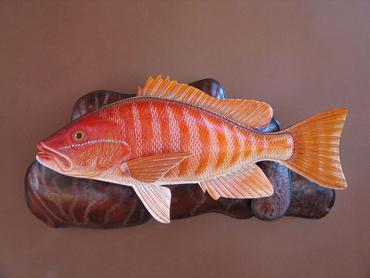 Red Snapper Sculpture hand tooled by Lance Marshall Boen. This unique fish art is inspired by Lance's passion for fly fishing. His works of art vary from larger than life leather fish sculptures to an Eagle made from vintage baseball gloves with a wingspan of nearly 12 feet.