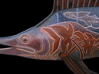 Sailfish Sculpture hand tooled by Lance Marshall Boen. This unique fish art is inspired by Lance's passion for fly fishing. His works of art vary from larger than life leather fish sculptures to an Eagle made from vintage baseball gloves with a wingspan of nearly 12 feet.