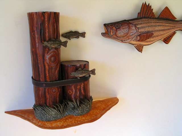 Peacock Bass Sculpture hand tooled by Lance Marshall Boen. This unique fish art is inspired by Lance's passion for fly fishing. His works of art vary from larger than life leather fish sculptures to an Eagle made from vintage baseball gloves with a wingspan of nearly 12 feet.