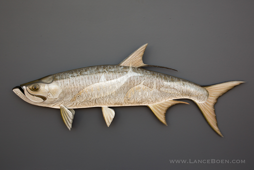 Tarpon Sculpture hand tooled by Lance Marshall Boen. This unique fish art is inspired by Lance's passion for fly fishing. His works of art vary from larger than life leather fish sculptures to an Eagle made from vintage baseball gloves with a wingspan of nearly 12 feet.
