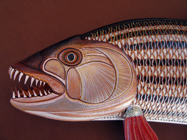 Tiger Fish Sculpture hand tooled by Lance Marshall Boen. This unique fish art is inspired by Lance's passion for fly fishing. His works of art vary from larger than life leather fish sculptures to an Eagle made from vintage baseball gloves with a wingspan of nearly 12 feet.