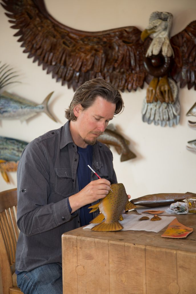 Lance Boen putting the final touches on a sculpture.
