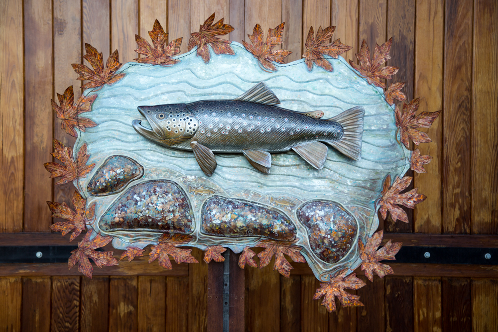 Autumn Brown Installation: Brown Trout with river background fly fishing artwork, leather sculpture