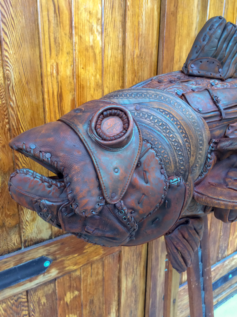 A leather sculpture of a steampunk themed bass