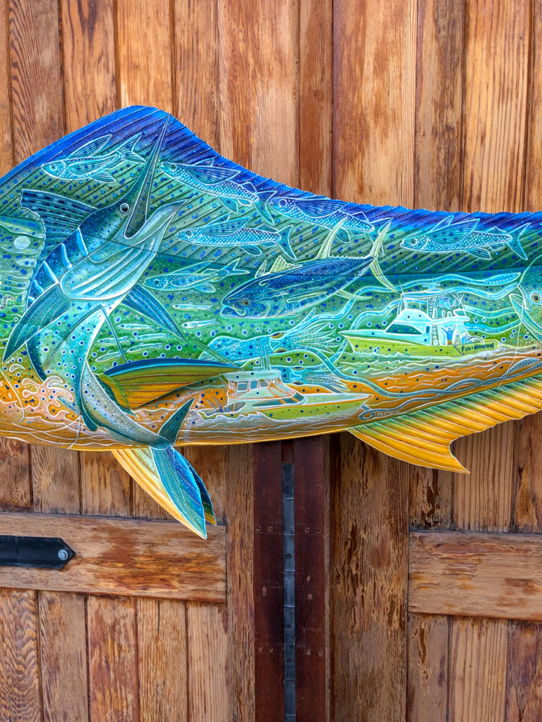 Brightly painted sculpture of a Dorado fish