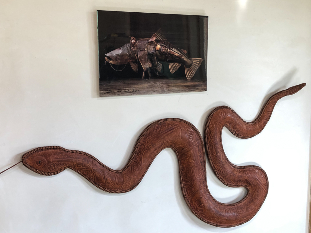 A print of a Bucking Rainbow Trout hangs on the wall