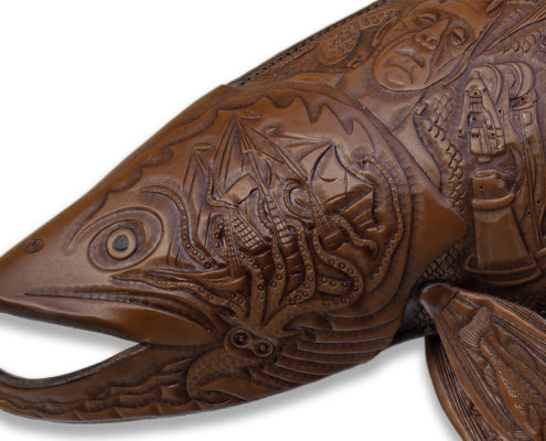 Tattooed Trout, a leather sculpture of a trout with hand tooled images of a Bigfoot, lochness monster, mermaid, and other fictional characters.